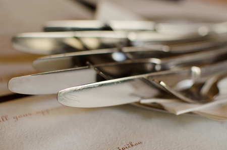 flatware: Served knifes and forks for dinner Stock Photo