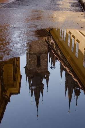 old church: Church of Mother of God before Týn roof reflection in puddle. Prague