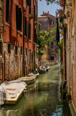 city park boat house: Tipical venetian street-canal with moored boats near a house. Venice, Italy