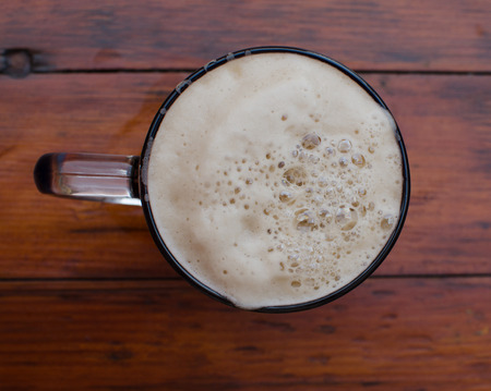 The mug of beer with foam. View from above. Stock Photo