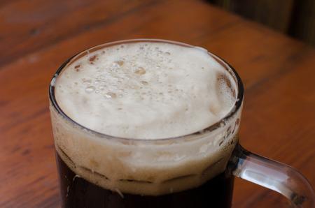 The mug of beer with foam
