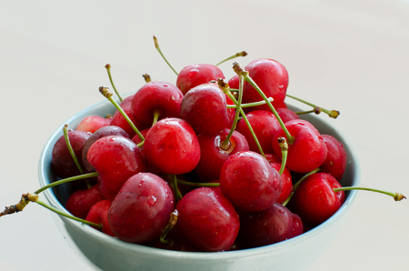 Cherry on the plate  on the white background