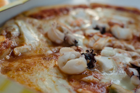 Pizza frutti di mare with octopus.