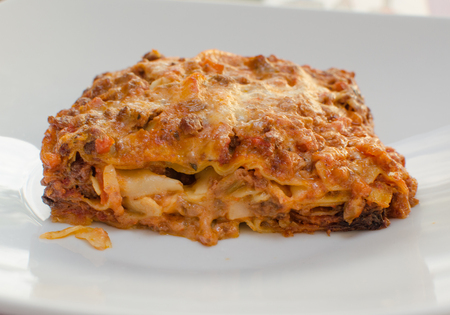 The portion of lasagna on the white plate Stock Photo