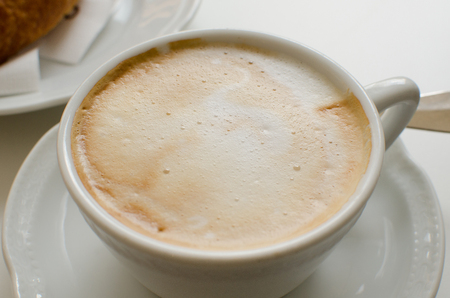 The cup of cappuccino with foam Stock Photo
