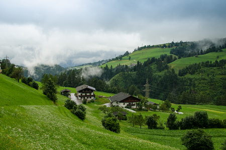 A country in tirolean valley with fog