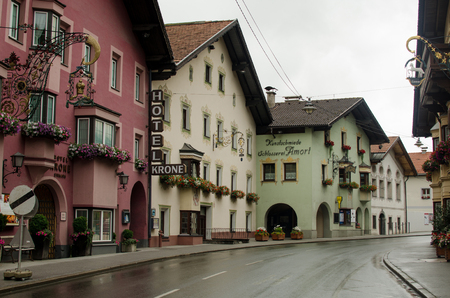 Tirolean street with tipical austrian houses Stock Photo