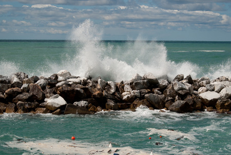 Panoramic of sea with rocks and splash