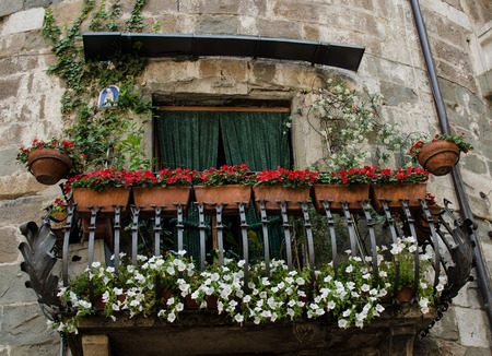 A balcony with flowers in Lucca Italy Stock Photo