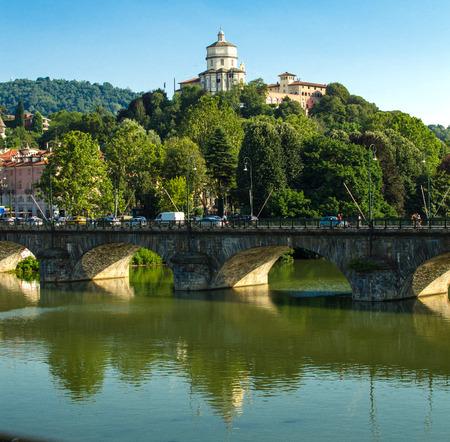 Church of Santa Maria di Monte dei Cappuccini with bridge reflected on the river Po Stock Photo