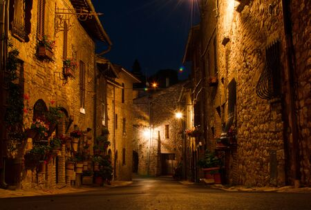 A medieval picturesque street in Assisi by night