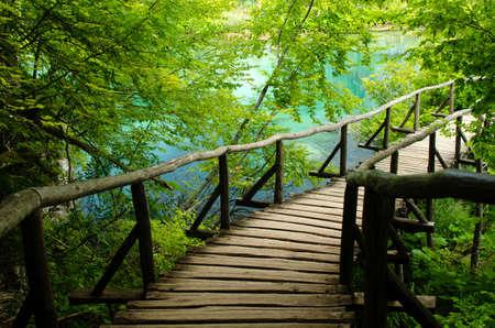 Wooden Bridge leading to the lake in Plitvice National Park in Croatia