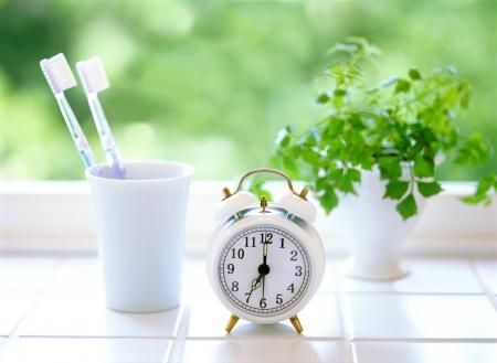 alarm clock and  toothbrush Stock Photo