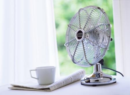 electric fan and newspaper Фото со стока - 21067971
