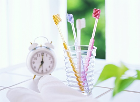 Four toothbrushes and alarm clocks