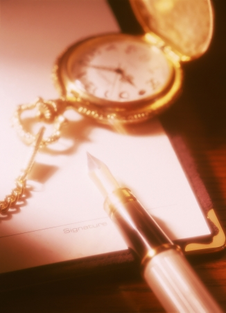 pocket watch and fountain pen photo