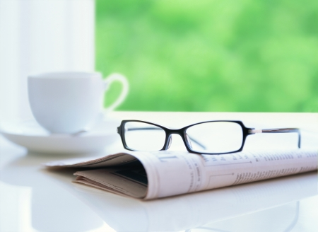 newspaper and glasses photo