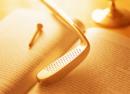 golf club and  book