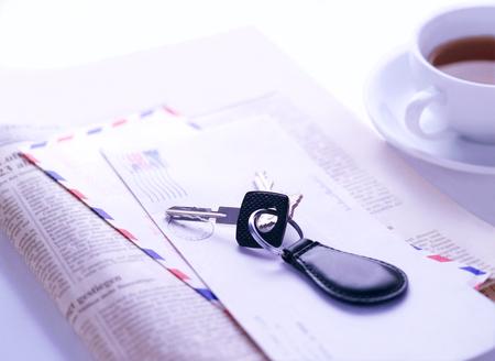key and newspaper Фото со стока - 24635790