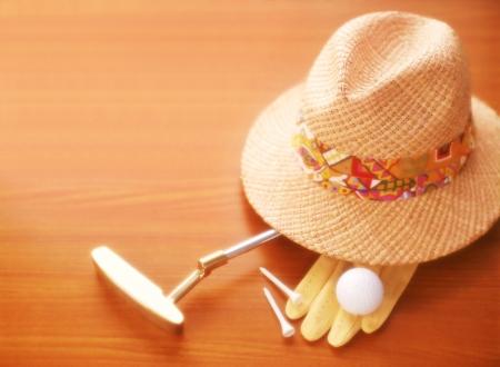 ゴルフ クラブと帽子