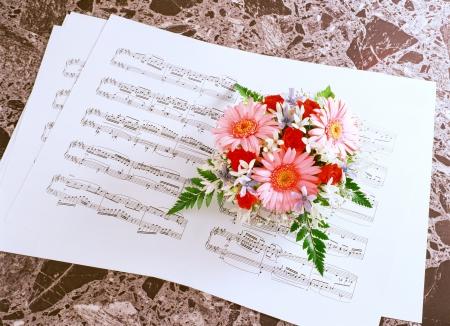 music score: music score and bouquet
