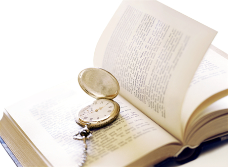 pocket watch and book Фото со стока