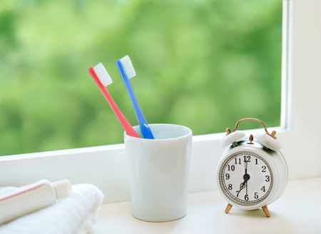 toothbrush and alarm clock