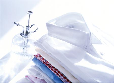 噴霧器とシャツ 写真素材
