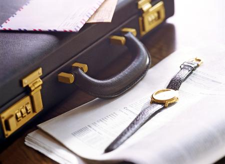 attache case: briefcase and newspaper