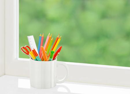 Pencils in mug Фото со стока