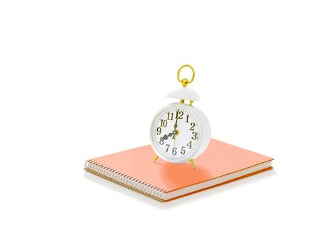 alarm clock and sketchbook Фото со стока - 106790739