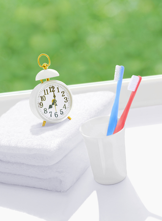 alarm clock and toothbrush