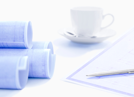 blueprint and coffee cup