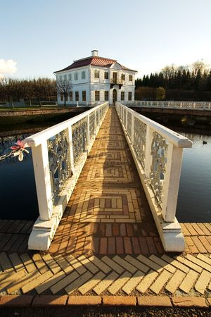 peterhof: The bridge with a white handrail and brick floor to a palace Marli, Peterhof, St. Petersburg, Russia Stock Photo