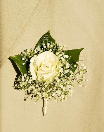 buttonhole: White bouquet in grooms buttonhole, white roses and pearls
