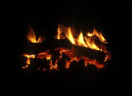 Burning down fire wood, fireplace, shine decayed coal in darkness Stock Photo - 5421379