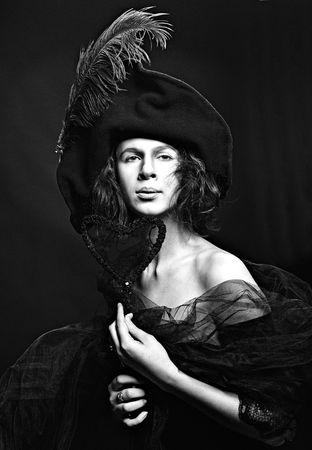 Portrait of high society medieval lady in hat, studio retro stilization, monochrome