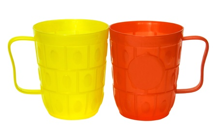 Yellow and red  plastic  glasses isolated on white background photo