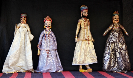 Four India puppets on black background photo
