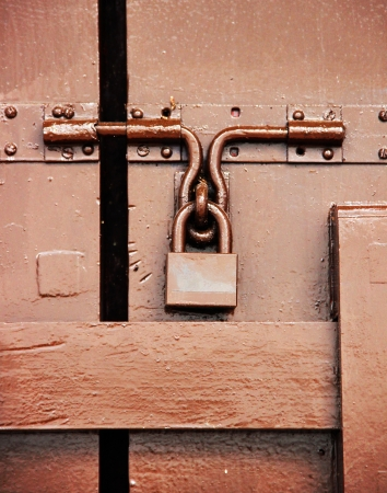 Brown padlock on brown hardwood door photo