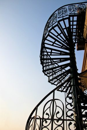 Spiral stair on blue sky background photo