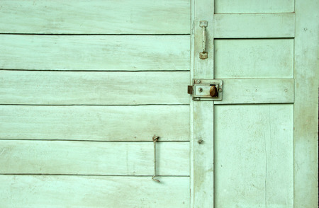 relate: Old wood door and green wall