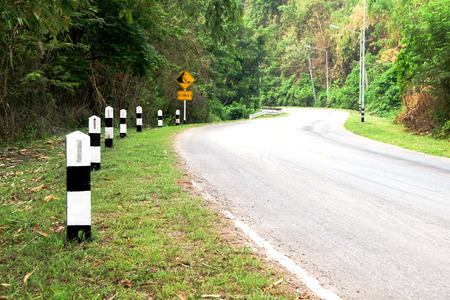 kilometer: Kilometer post beside curve road