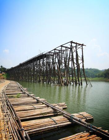 Teak wood bridge was break up from flash flood, Kanchanaburi province, Thailand photo