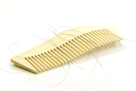 comb hair: Loss hair with white brush on white background