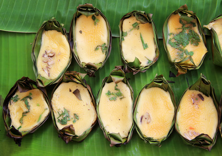 Grilled eggs in banana leaf joist, tradition Asia food photo