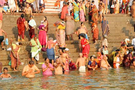 benares: VARANASI, INDIA - OCTOBER 23: Hindu people take a bath in the river ganges in the morning on October 23, 2014  at ghat in Varanasi, Uttar Pradesh, India. Editorial