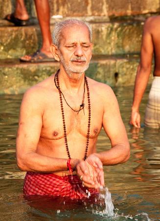 uttar pradesh: VARANASI, INDIA - OCT. 23 : A man pray at Ganga river on October 23, 2014  in Varanasi, Uttar Pradesh, India. Ganga river is holy river for Hindu people