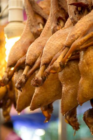 arrange: Pot-stewed ducks arrange for sale in market