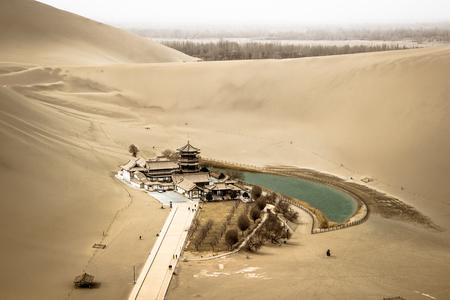 crescent: Mingsha shan desert and Crescent moon lake in Dunhuang, Gansu, China Stock Photo